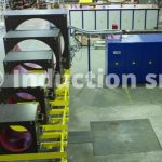 Induction heating plant and set of coils for coating process