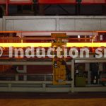 Induction heating plants for hot rolling mills