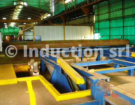 Loading and unloading tables for induction heating plants