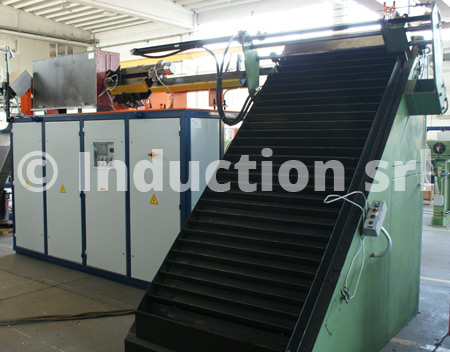 Induction heating plant for metals hot forging with rolling shutter loader