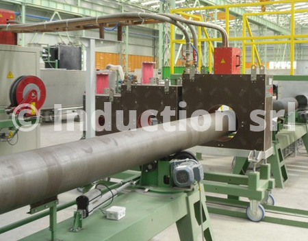 Induction heating plant for tubes coating