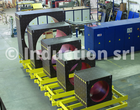 Induction heating plant and coils set for tubes industry