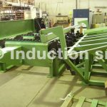 Mechanical design of loading tables and chargers for induction heating plants