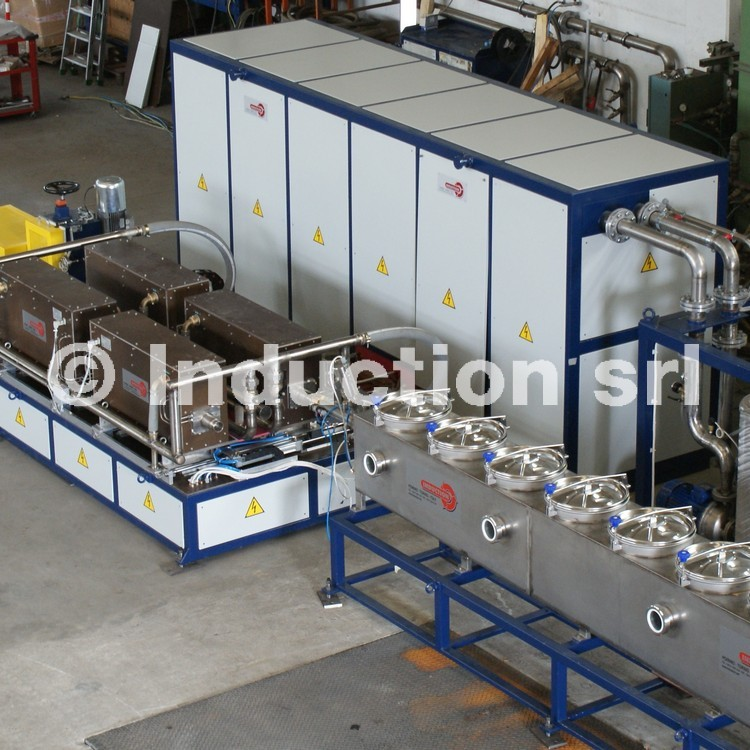 Induction heating plants in controlled atmosphere