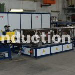 Complete line for induction heating in controlled atmosphere