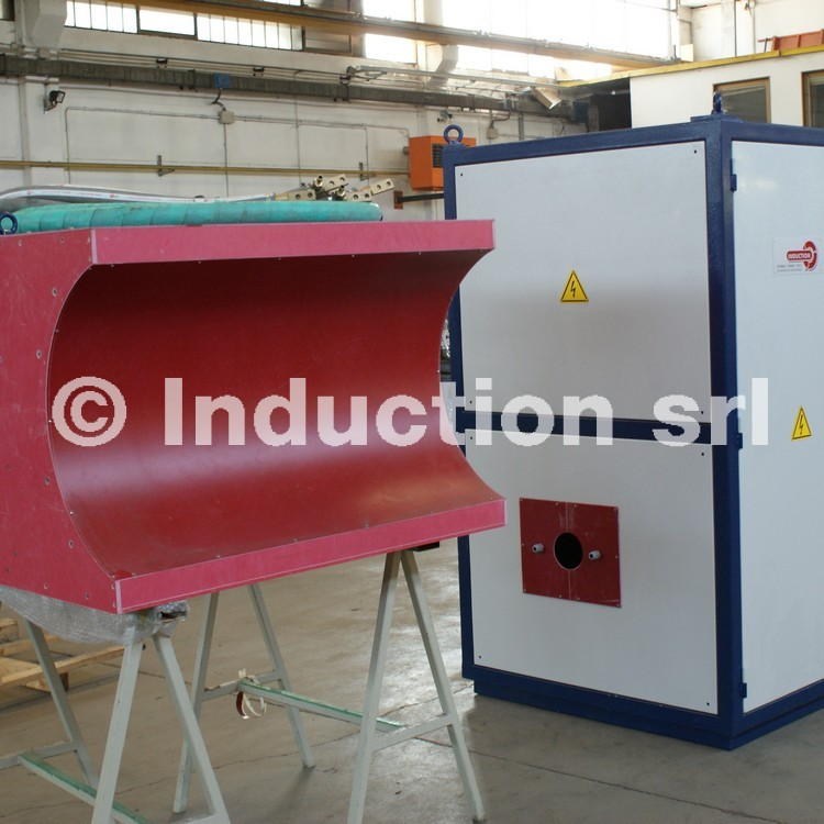 Induction heating plant for coating with pancake heating coil