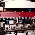 Integrated induction heating system for electric motors
