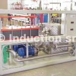 Water cooling group with heat exchangers and pumps for induction heating plant